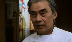 Burt Kwouk in She Good Fighter (1995)